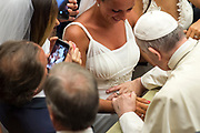 August 23, 2017 : Pope Francis blesses the womb of a pregnant bride during his Wednesday general audience in Paul VI's hall at the Vatican. Antoine Mekary | Aleteia | I.Media