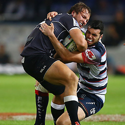 DURBAN, SOUTH AFRICA - MAY 29: Jack Debreczeni of the Rebels with a tackle on Andre Esterhuizen of the Cell C Sharks during the Super Rugby match between Cell C Sharks and Melbourne Rebels at Growthpoint Kings Park on May 29, 2015 in Durban, South Africa. (Photo by Steve Haag/Gallo Images)