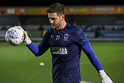 AFC Wimbledon goalkeeper Joe Day (21) warming up prior to kick off during the EFL Sky Bet League 1 match between AFC Wimbledon and Burton Albion at the Cherry Red Records Stadium, Kingston, England on 28 January 2020.