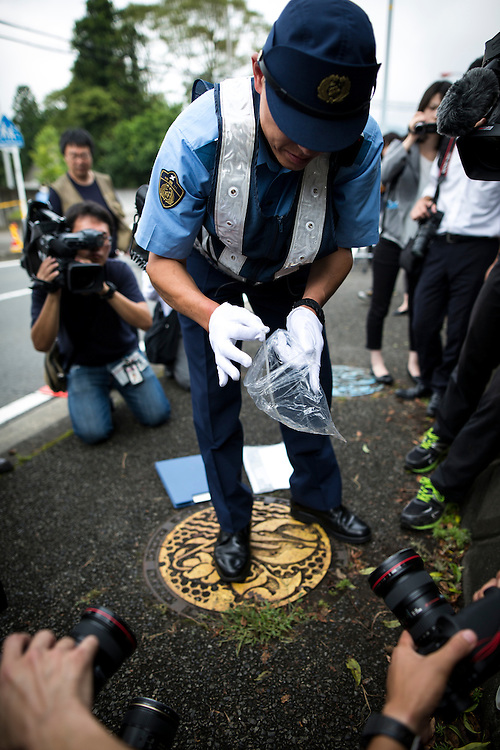 SAGAMIHARA, JAPAN - JULY 27 :  Police investigators collecting a found object dropped by the suspect in front of the entrance of Tsukui Yamayuri-en building at Sagamihara on Wednesday, July 27, 2016 Kanagawa prefecture, Japan. Police arrested 26 year old Satoshi Uematsu after breaking inside the building facility for handicapped and killing 19 people and injuring 20 in the city of Sagamihara, west of Tokyo. (Photo: Richard Atrero de Guzman/NURPhoto)