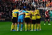 Watford players huddle ahead of the Premier League match between Bournemouth and Watford at the Vitality Stadium, Bournemouth, England on 12 January 2020.