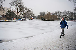 © Licensed to London News Pictures. 01/03/2018. London, UK. The canal way frozen over in Little Venice, North London as the capital continues to be hit by extreme winter conditions. Large parts of the UK are experiencing disruption as freezing temperatures continue. Photo credit: Ben Cawthra/LNP
