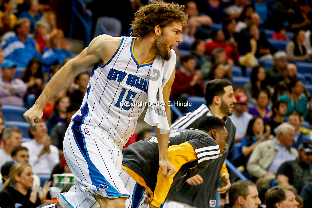 Feb 13, 2013; New Orleans, LA, USA; New Orleans Hornets center Robin Lopez (15) and teammates react from the bench during the second half of a game against the Portland Trail Blazers at the New Orleans Arena. The Hornets defeated the Trail Blazer 99-63. Mandatory Credit: Derick E. Hingle-USA TODAY Sports