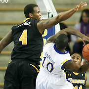 Delaware (#10) Devon Saddler attempts to drive by Towson defender  #4  Braxton Dupree during game against Towson Saddler finished the game with 20 points. Delaware defeated Towson 80-70 at The Bob Carpenter Center Wednesday night In Newark Delaware.