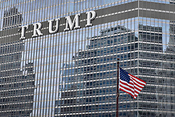 """© Licensed to London News Pictures. 21/12/2017. CHICAGO, USA.  The sign adorning the exterior of Trump International Hotel and Tower in downtown Chicago displays the word """"TRUMP"""" in 20 foot high letters.  The United Nations has just voted to reject US President Donald Trump's recognition of Jerusalem as capital of Israel.  Photo credit: Stephen Chung/LNP"""