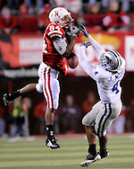 November 21, 2009: Defensive back Joshua Moore #4 of the Kansas State Wildcats brakes up a pass intended for wide receiver Brandon Kinnie #84 of the Nebraska Cornhuskers in the third quarter at Memorial Stadium in Lincoln, Nebraska.