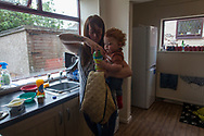 Victoria Cunningham prepares food for her son Oliver-James in the kitchen of the house the family rents in Bradford, Great Britain Monday, May 26, 2014. Through Save the Children's EAT, SLEEP, LEARN AND PLAY programme the family was awarded a fridge freezer and a toy and book pack. A record five million children in the UK could be trapped in poverty by 2020, according to new research by Save the Children. The report reveals that children have paid the highest price in the recession, with families having been hit by years of flat wages, cut to benefits and the rising cost of living. (Elizabeth Dalziel for Save the Children )