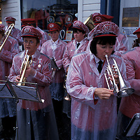Europe, Norway, Marching band performs in pouring rain at street festival in Stavanger, Norway