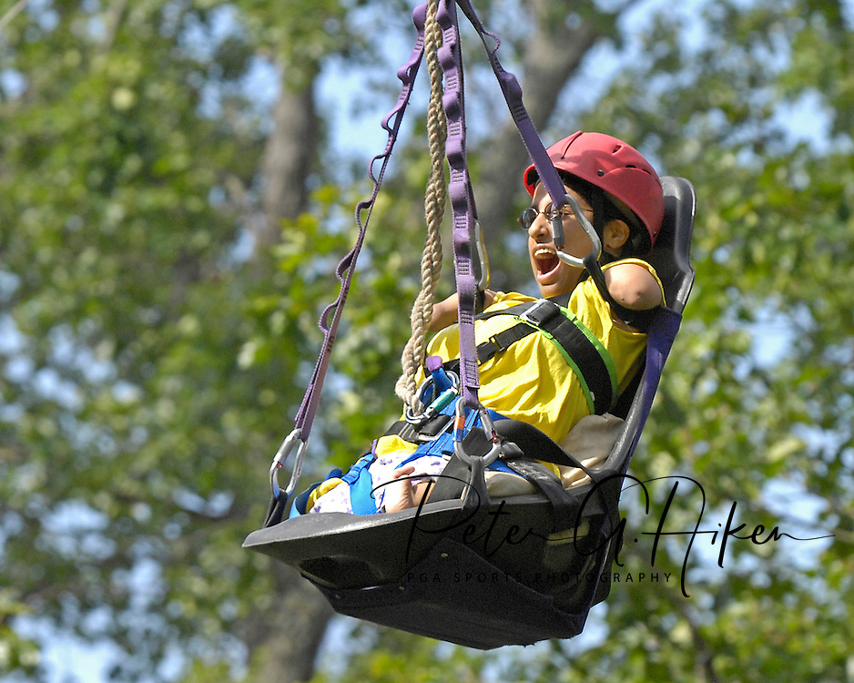 Directv Magazine -- Minda Cox reacts as she flies down the zip line at Camp Barnabas.