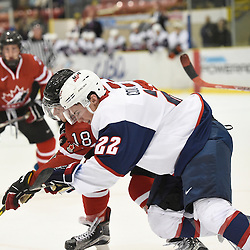 WELLINGTON, - Dec 11, 2015 -  Exhibition Game 2- Team USA vs Team Canada East at the 2015 World Junior A Challenge at the Wellington District Community Centre, ON. Ross Colton #22 of Team United States tries to keep the puck from Tyler Rollo #18 of Team Canada East during the second period.<br /> (Photo: Andy Corneau / OJHL Images)