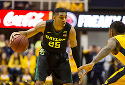 Feb 6, 2016; Morgantown, WV, USA; Baylor Bears guard Al Freeman (25) dribbles the ball while guarded by West Virginia Mountaineers guard Daxter Miles Jr. (4) during the first half at the WVU Coliseum. Mandatory Credit: Ben Queen-USA TODAY Sports