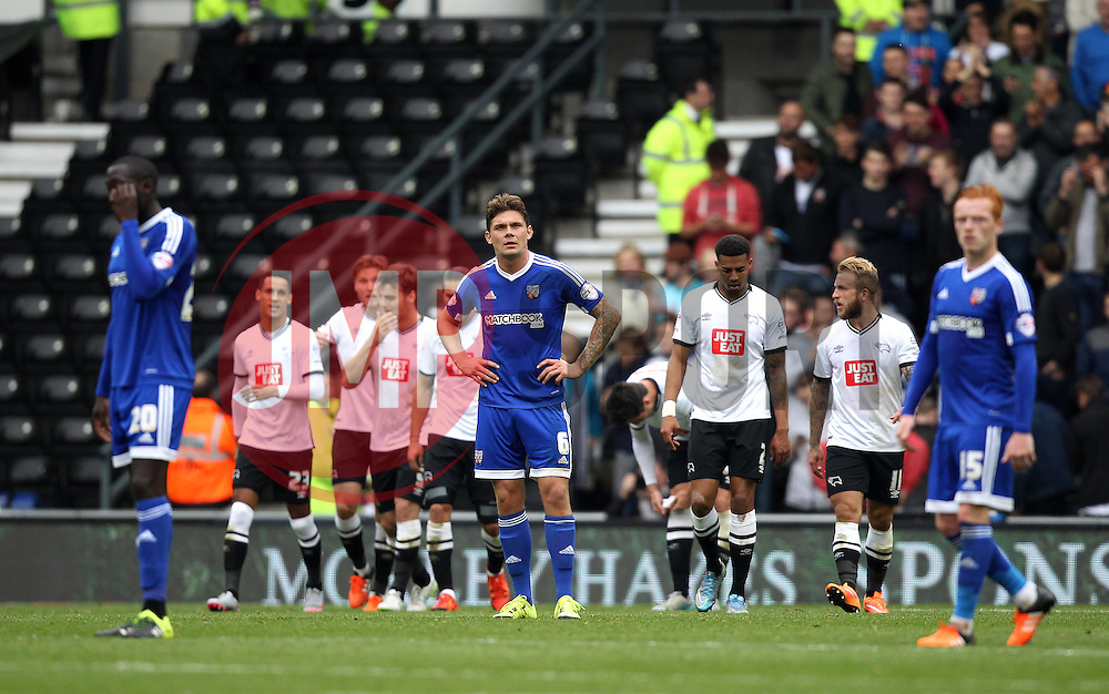 Harlee Dean of Brentford, Ryan Woods of Brentford and Toumani Diagouraga of Brentford cut frustrated figures after conceding a second goal to Derby County - Mandatory byline: Robbie Stephenson/JMP - 07966 386802 - 03/10/2015 - FOOTBALL - iPro Stadium - Derby, England - Derby County v Brentford - Sky Bet Championship