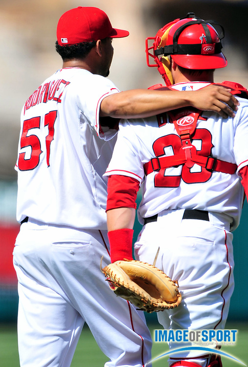 Jul 19, 2008; Anaheim, CA, USA; Los Angeles Angels reliever Francisco Rodriguez (57), left, puts his arm around catcher Ryan Buddle (28) after 4-2 victory over the Boston Red Sox at Angel Stadium. Mandatory Credit: Kirby Lee/Image of Sport-US PRESSWIRE