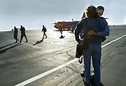 As other soldiers leave from the plane Chief Warrant Officer Joe Hagerty hugs his wife Marji Feliz upon returning home to spend Thanksgiving holiday with their loved ones. More than 50 California National guard troops returned to Mather Field and are tentatively set leave for their overseas mission by the end of the year. Picture taken Monday, November 22, 2004.