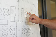 A staff member points to a map of the cell blocks as media members tour the newest prison in Pennsylvania Friday, September 01, 2017 at State Correction Institution Phoenix in Skippack, Pennsylvania. The facility is inching closer to opening, two years late, to replace Graterford Prison at a cost of $400 million. (Photo by William Thomas Cain/CAIN IMAGES)