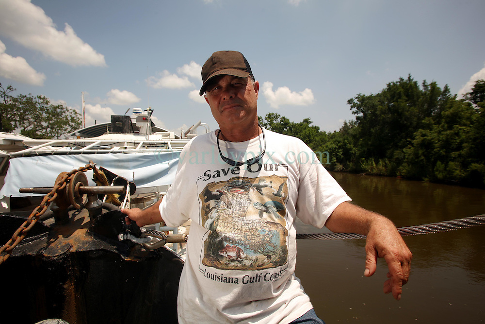 10 June 2010. Breton Sound Marina, Hopedale, Louisiana. USA.  <br /> Ricky Robin, captain of the boat 'Lil Rick.' Robin, a commercial fisherman since he was a teenager is now subcontracted to BP. Robin awaits equipment to be loaded onto his shrimp boat which has been converted to an oil skimming vessel. Robin doubts how effective the equipment will be and suggests BP should leave such work to the professionals.<br /> The ecological and economic impact of BP's oil spill is devastating to the region. Oil from the Deepwater Horizon catastrophe is evading booms laid out to stop it thanks in part to the dispersants which means the oil travels at every depth of the Gulf and washes ashore wherever the current carries it. The Louisiana wetlands produce over 30% of America's seafood and oil and gas production. They are the most fertile wetlands and nurseries of their kind in the world. BP's oil is killing everything.<br /> Photo; Charlie Varley/varleypix.com