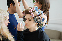 Models Being Prepared for Photo Shoot