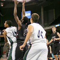 Forward Larry Miller (50) finds the pass between Wolves forwards Kyndall Smith-Tomlin (42) and John Hummel (45)