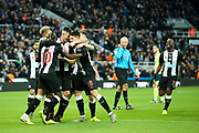 Ciaran Clark (#2) of Newcastle United celebrates Newcastle United's second goal (2-1) with Newcastle United team mates during the Premier League match between Newcastle United and Bournemouth at St. James's Park, Newcastle, England on 9 November 2019.