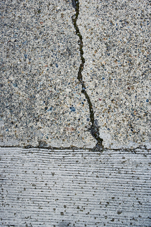 Cracks in concrete pavement.
