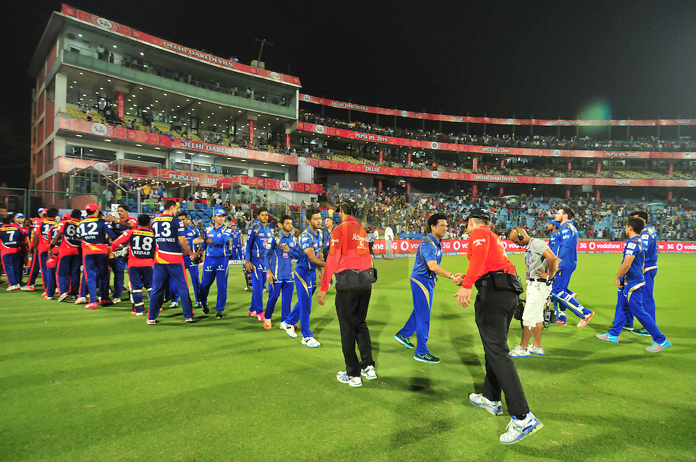 Mumbai Indians players  shake hands with Delhi Daredevils  players after match 21 of the Pepsi IPL 2015 (Indian Premier League) between The Delhi Daredevils and The Mumbai Indians held at the Ferozeshah Kotla stadium in Delhi, India on the 23rd April 2015.<br /> <br /> Photo by:  Arjun Panwar / SPORTZPICS / IPL