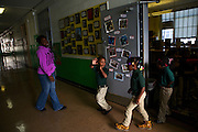 Nathan McNeill, 4, signals for his classmates to be quiet as they exit the library that was renovated through the Target School Library Makeover Grant at Adelaide Davis Elementary School on Nov. 26, 2012 in Washington, D.C. Last week DCPS Chancellor Kaya Henderson proposed closing 20 under-enrolled schools in the District. Davis Elementary is one of 20 schools in the DCPS system included in the school closure proposal. There are currently 178 students enrolled in Davis Elementary and the second floor of the school is only used for music classes and the library...CREDIT: Lexey Swall for The Wall Street Journal.DCSCHOOLS
