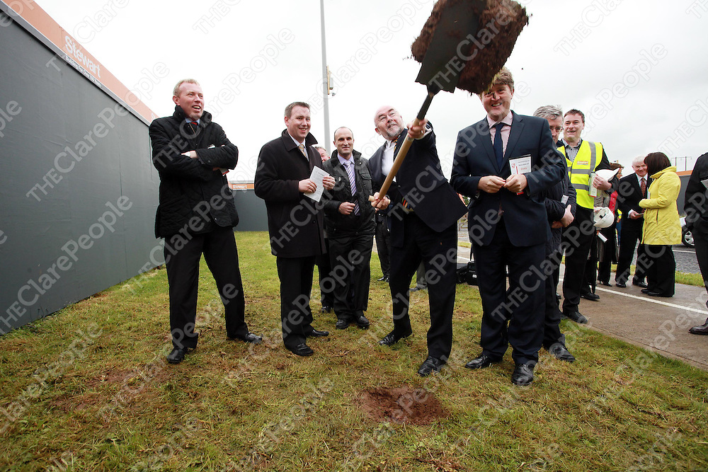 Minister for Education and Skills Ruairi Quinn flips the sod as Timmy Dooley, Joe Carey and Michael McNamara look on during a visit to Ennis National School to turn the sod on the new building on Friday morning.<br /> Photograph by Press 22