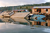 Half sunk fishing boat in a water village, Manokwari, West Papua, Indonesia. Manokwari is a small town on the north east coast of the Bird's Head Peninsula, West Papua, Indonesia.  Its harbour has many wrecks from WWII.