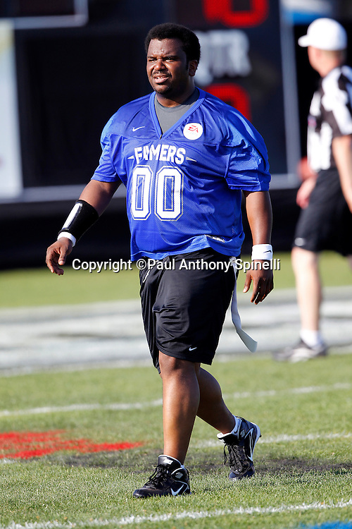 Actor Craig Robinson (00) of the Famers team plays flag football in the EA Sports Madden NFL 11 Launch celebrity and NFL player flag football game held at Malibu Bluffs State Park on July 22, 2010 in Malibu, California. (©Paul Anthony Spinelli)
