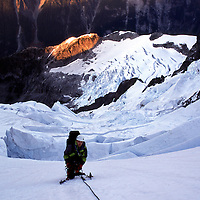02BKR130 MODEL RELEASED.Kevin Kanning waits for the rope to go tight on the final pitch of the Price Glacier, Mt. Shuksan, Washington. Even starting early from the sunlit ridge below it takes most parties the good part of a day to find their way up the shattered Price Glacier...This photograph is copyright Tim Matsui Photography and may not be reproduced without a copyright license. ..If you wish to license the use of this photograph contact Tim Matsui Photography at photo@timmatsui.com,  call 206.409.3069, or visit www.timmatsui.com..