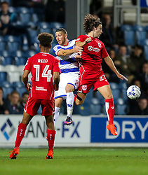 Conor Washington of Queens Park Rangers and Adam Matthews of Bristol City compete in the air - Rogan Thomson/JMP - 18/10/2016 - FOOTBALL - Loftus Road Stadium - London, England - Queens Park Rangers v Bristol City - Sky Bet EFL Championship.