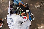 May 19 - BANGKOK, THAILAND: A Thai medic tends to a dead protester in Lumpini Park during the Thai government crack down against Red Shirt and anti government protesters. The Royal Thai Army attacked anti-government protesters May 19 with troops and armored personnel carriers. Photo by Jack Kurtz