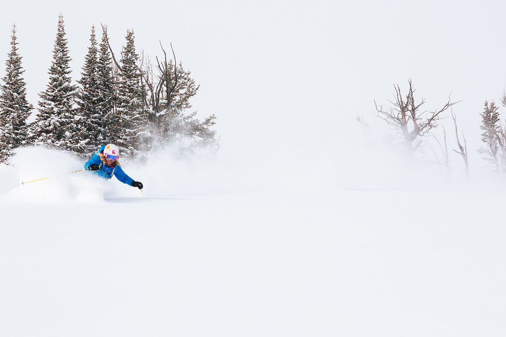 Jess McMillan blazes through untracked powder during a brief clearing while a winter storm covers the Teton backcountry near Jackson Hole Mountain Resort, Teton Village, Wyoming.