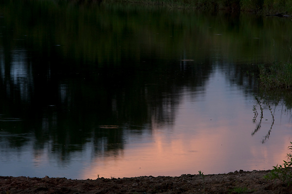 Stock photo of the sunset reflection on the bank of the Llano River in the Texas Hill Country