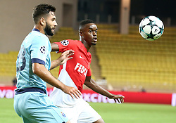 FONTVIEILLE, Sept. 27, 2017  Adama Diakhaby (R) of Monaco vies with Felipe of Porto during the match of Group G of 2017-18 season Champions League in Monaco on Sept. 26, 2017. Porto won 3-0. (Credit Image: © Serge Haouzi/Xinhua via ZUMA Wire)