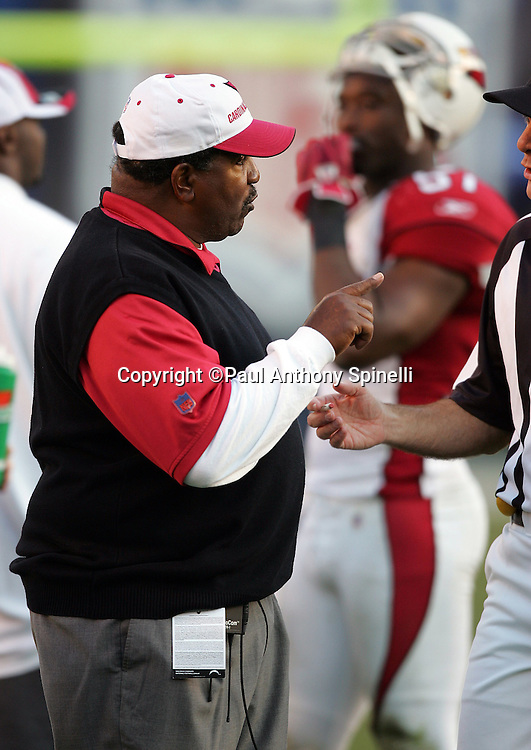 SAN DIEGO - DECEMBER 31:  Head Coach Dennis Green of the Arizona Cardinals points at an NFL official during the game against the San Diego Chargers at Qualcomm Stadium on December 31, 2006 in San Diego, California. The Chargers defeated the Cardinals 27-20 to secure the number one seed in the AFC playoffs. ©Paul Anthony Spinelli *** Local Caption *** Dennis Green