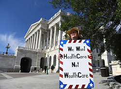 June 27, 2017 - Washington, District of Columbia, U.S. - A woman protests against the new health care bill on Capitol Hill. Senate Republicans have delayed the vote to repeal and replace ObamaCare until after lawmakers return from the July 4 recess. (Credit Image: © Yin Bogu/Xinhua via ZUMA Wire)