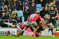Ollie Devoto of Exeter Chiefs is tackled by Billy Twelvetrees of Gloucester Rugby and Gareth Evans of Gloucester Rugby - Mandatory by-line: Ryan Hiscott/JMP - 24/11/2018 - RUGBY - Sandy Park Stadium - Exeter, England - Exeter Chiefs v Gloucester Rugby - Gallagher Premiership Rugby