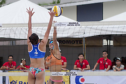 May 5, 2018 - Pasay, National Capital Region, Philippines - The first day of FIVB (Fédération Internationale de Volleyball) Beach Volleyball World Tour, Manila Open 2018, with its third day for women's quarter finals. Games are held on Sands SM by the Bay area of SM Mall of Asia...Its Philippines versus Japan for the quarter finals. Philippines team in blue top are (1) Cherry Ann Rondina and (2) Angeline Marie Gervacio. Japan team in orange top are (1) Shinako Tanaka and (2) Sakurako Fuji...Shinako Tanaka attempts a score while Cherry Ann Rondina anticipates it with a block. (Credit Image: © George Buid via ZUMA Wire)