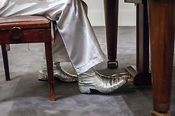 """© Licensed to London News Pictures. 27/08/2015. London, UK. The sequined boots of Benny from ABBA tribute band, Björn Again, who was performing at the photocall at Sotheby's for the upcoming auction of the """"ABBA piano"""", the instrument on which ABBA recorded their most celebrated songs including """"Mamma Mia"""", """"Waterloo"""" and """"Dancing Queen"""".  Estimated at £600,000-800,000, the piano will be part of Sotheby's Rock and Pop auction on 29 September. Photo credit : Stephen Chung/LNP"""