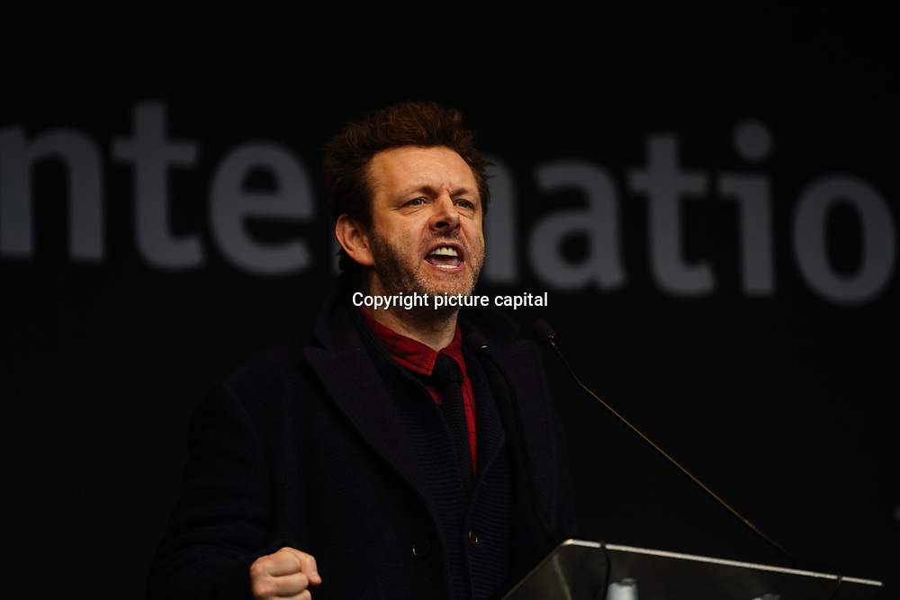 London, UK. 4th March 2018. Michael Sheen is an actor join Women's Day march 2018 marks 100 years since (some) women in the UK were legally allowed to vote. One hundred years on women still marching for equality demand 50/50 women in  Paliament calling for an end sexual harassment, violence and rape.
