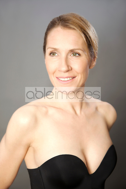 Woman wearing strapless black bodice