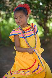 Central America, Nicaragua, Granada. Girl in traditional dress dancing in Villa Esperanza barrio.  MR
