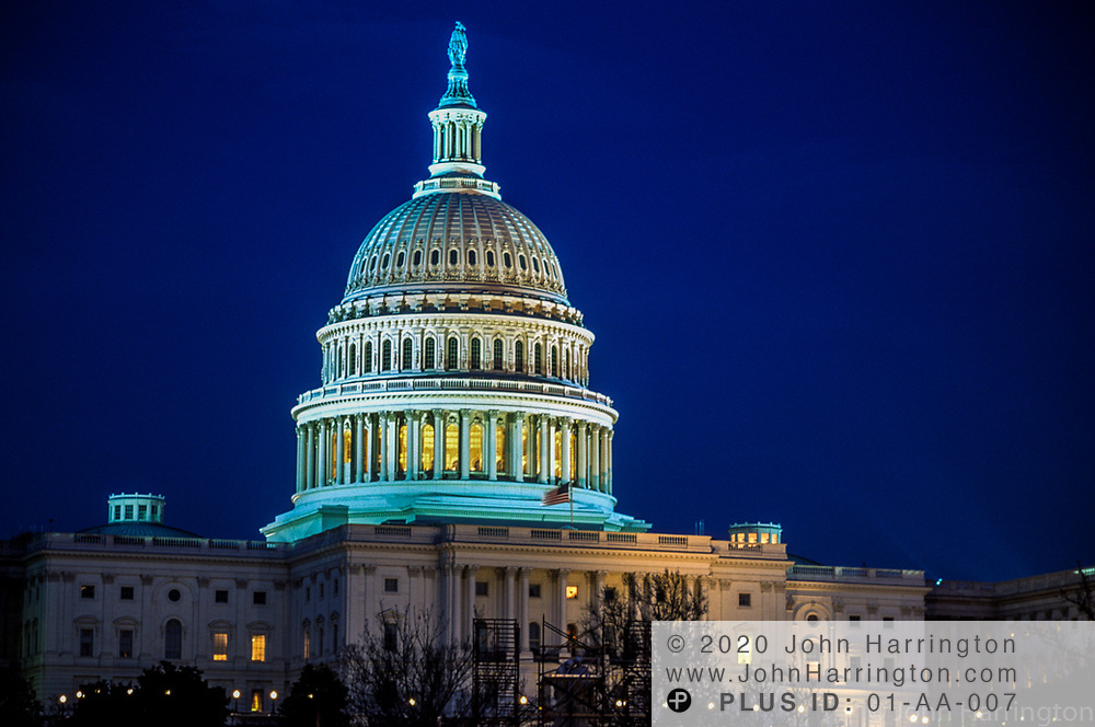 The US Capitol at nighttime.