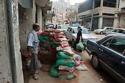 Sunni neighborhood Bab al-Tebbaneh. Sandbags and filled tires protect against Alawites snipers. Tripoli, Lebanon...<br /> <br /> Quartier Sunnite. Rue de Syrie. Sacs de sable   remplis de remblais pour prortéger les habitants des balles qui viennent du quartier Allouite.