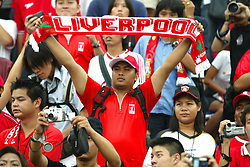 BANGKOK, THAILAND - Thailand. Thursday, July 24, 2003: Thai Liverpool fans watch their heroes take on the Thailand National Team during a preseason friendly match at the Rajamangala National Stadium. (Pic by David Rawcliffe/Propaganda)