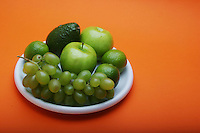 Exotic fruits on white plate