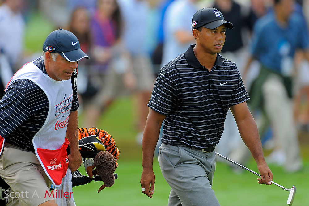 Tiger Woods (USA) and his caddie Steve Williams approach the green on the first hole during third round of the PGA Tour Championship the final event of the 2009 FedEx Cup at East Lake Golf Club on Sept. 26, 2009 in Decatur, Ga.     ..©2009 Scott A. Miller