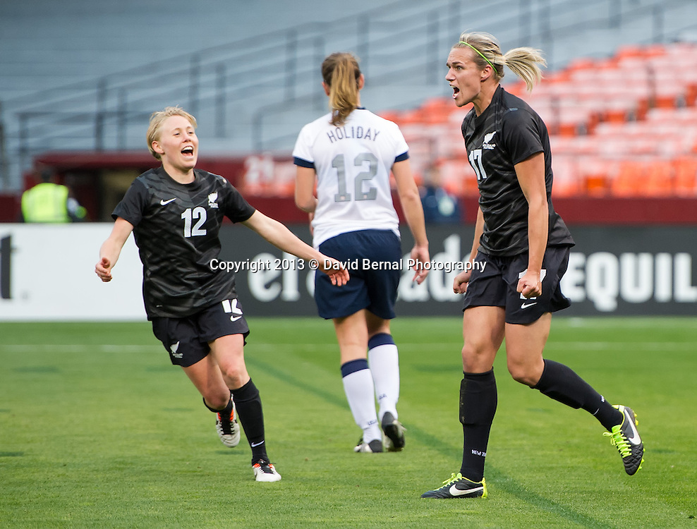 Betsy Hassett (L) runs to celebrate Hannah Wilkinson's goal - SAN FRANCISCO, CA - October 27, 2013:  The US Women's National Team vs New Zealand match in Candlestick Park in San Francisco, CA. Final score US Women's National Team 4, New Zealand 1.