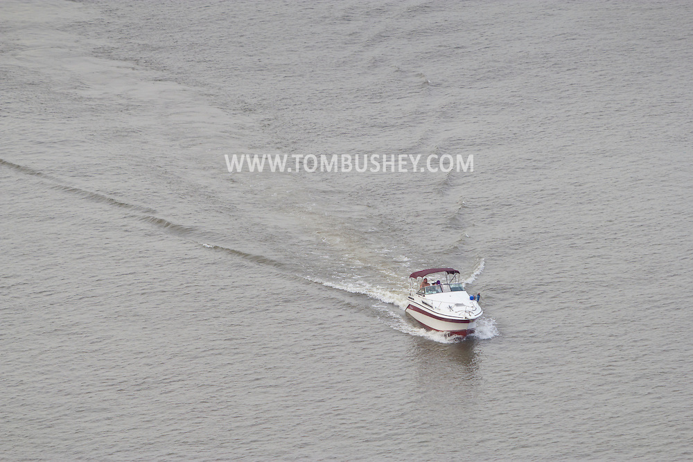 Highland, New York - A boat cruises on the Hudson River in a view from the Walkway over the Hudson on May 27, 2012.